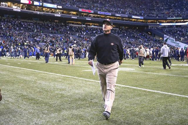 Dec 14, 2014; Seattle, WA, USA; San Francisco 49ers head coach Jim Harbaugh walks back to the locker room  following a 17-7 Seattle Seahawks victory at CenturyLink Field. (Joe Nicholson-USA TODAY  ...