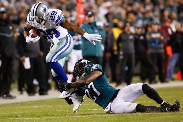 Dec 14, 2014; Philadelphia, PA, USA; Dallas Cowboys running back DeMarco Murray (29) catches the ball and is tackled by Philadelphia Eagles free safety Malcolm Jenkins (27) during the first half a ...