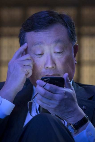 BlackBerry Chief Executive John Chen uses the new Blackberry Classic smartphone during the launch event in New York, December 17, 2014. BlackBerry Ltd launched its long-awaited Classic device on W ...
