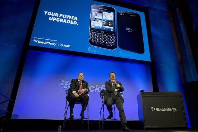BlackBerry Chief Executive John Chen (R) answers questions during the launch event for the new Blackberry Classic smartphone  in New York, December 17, 2014. (REUTERS/Brendan McDermid)