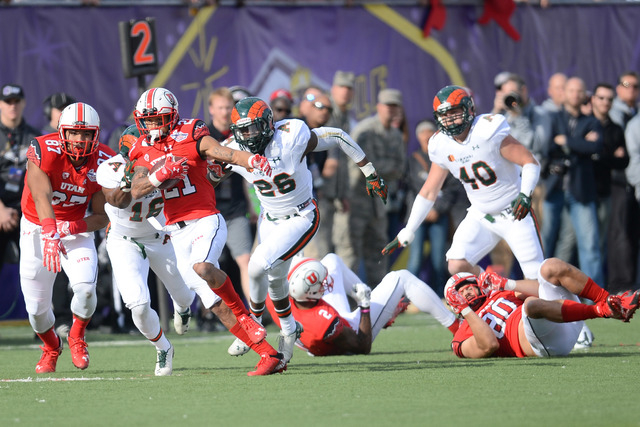 Utah Utes running back Troy McCormick (21) rushes the ball against the Colorado State Rams during the first half of the Las Vegas Bowl at Sam Boyd Stadium. (Joe Camporeale-USA TODAY Sports)