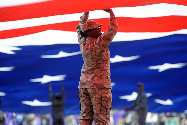 A United States Air Force member presents the American flag during the first half of the Las Vegas Bowl between the Colorado State Rams and the Utah Utes at Sam Boyd Stadium. (Joe Camporeale-USA T ...