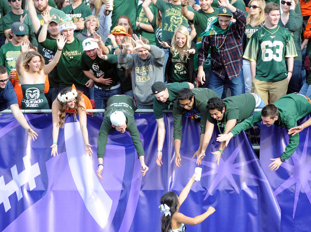 Colorado State Rams reach for a tee shirt from a cheerleader during the first half of the Las Vegas Bowl against the Utah Utes at Sam Boyd Stadium. (Joe Camporeale-USA TODAY Sports)