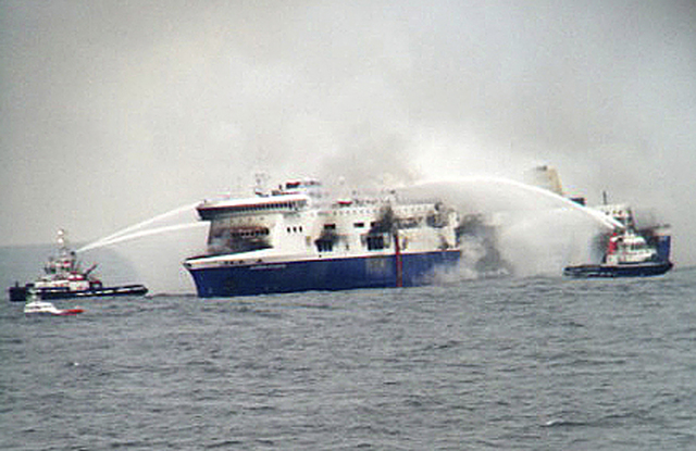 Fire fighting tug boats douche the burning car ferry Norman Atlantic in south Adriatic sea December 28, 2014. Hundreds of passengers were trapped on the ferry off Greece on Sunday, pleading to be  ...