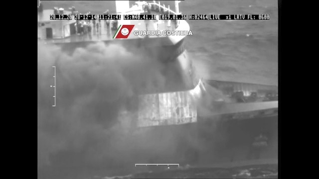 The car ferry Norman Atlantic burns in waters off Greece December 28, 2014 in this handout video grab of Italian Coast Guard. Italian and Greek helicopter crews prepared to work through the night  ...