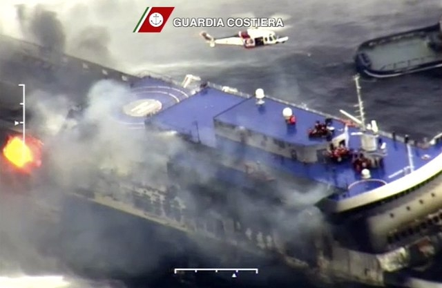 The car ferry Norman Atlantic burns in waters off Greece December 28, 2014 in this handout video grab of the Italian Coast Guard. Italian and Greek helicopter crews prepared to work through the ni ...