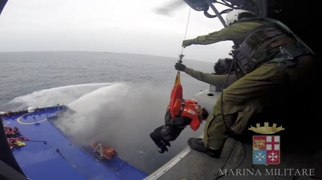 A person is lifted on an Italian Navy helicopter as the car ferry Norman Atlantic burns in waters off Greece December 28, 2014 in this handout video grab of the Italian Marina Militare. Italian an ...