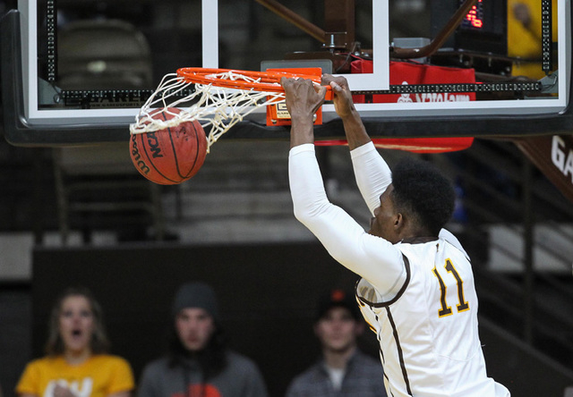 Wyoming Cowboys forward Derek Cooke Jr. (11) dunks against the UNLV Runnin' Rebels during the first half at Arena-Auditorium. The Cowboys defeated the Runnin' Rebels 76-71.  (Troy Babbitt-USA TODA ...