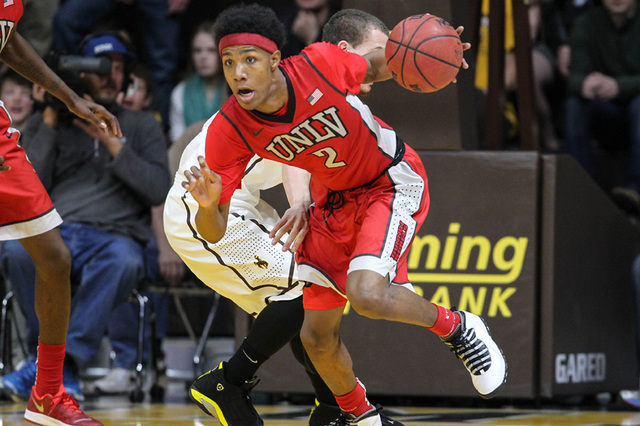 UNLV Runnin' Rebels guard Patrick McCaw (2) battles Wyoming Cowboys guard Josh Adams (14) during the first half at Arena-Auditorium. The Cowboys defeated the Runnin' Rebels 76-71.  (Troy Babbitt-U ...