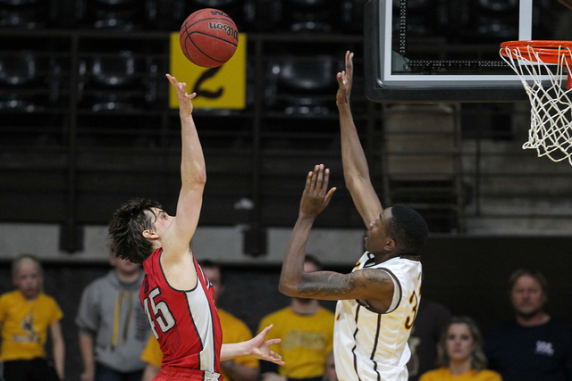 Wyoming Cowboys forward Alan Herndon (32) blocks a shot by UNLV Runnin' Rebels guard Cody Doolin (45) during the second half at Arena-Auditorium. The Cowboys defeated the Runnin' Rebels 76-71.  (T ...
