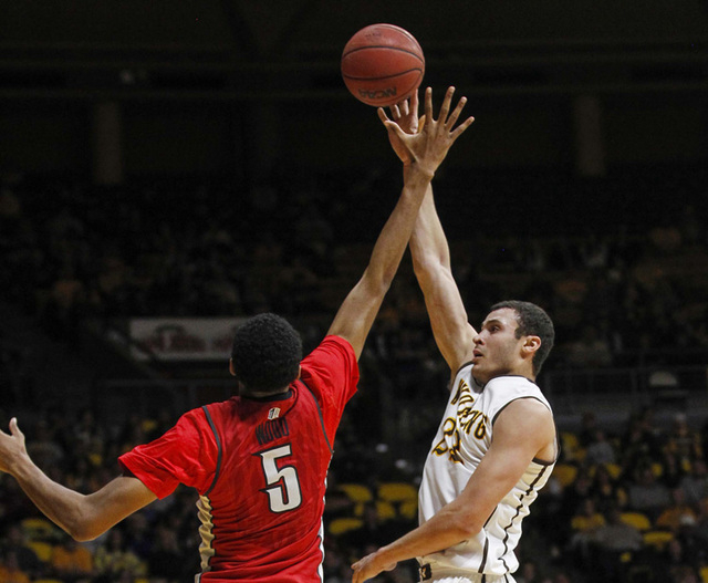 Wyoming Cowboys forward Larry Nance Jr. (22) shoots over UNLV Runnin' Rebels forward Christian Wood (5) during the second half at Arena-Auditorium. The Cowboys defeated the Runnin' Rebels 76-71.   ...
