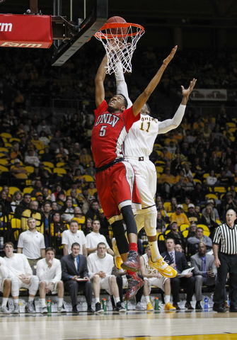 UNLV Runnin' Rebels forward Christian Wood (5) is fouled by Wyoming Cowboys forward Derek Cooke Jr. (11) during the second half at Arena-Auditorium. The Cowboys defeated the Runnin' Rebels 76-71.  ...