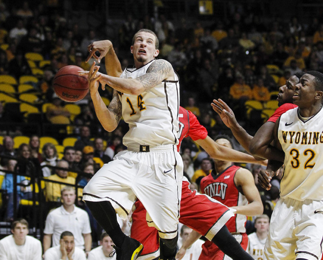 Dec 31, 2014; Laramie, WY, USA; Wyoming Cowboys guard Josh Adams (14) is fouled by UNLV Runnin' Rebels forward Christian Wood (back) during the second half at Arena-Auditorium. The Cowboys defeate ...