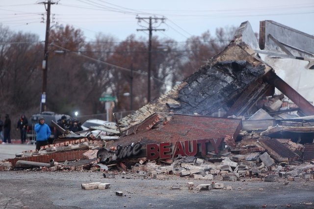 Smoldering remains is all this left of a beauty supply that burned to ground Tuesday, Nov. 25, 2014, in Dellwood, Mo. The building and several others in and around Ferguson were burned during prot ...