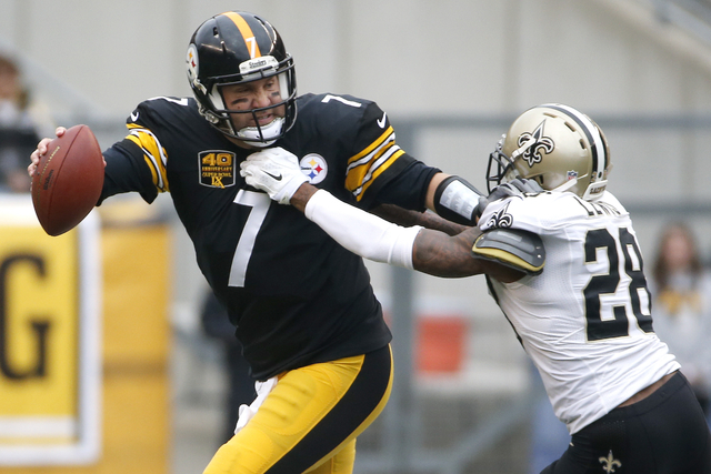 Pittsburgh Steelers quarterback Ben Roethlisberger (7) scrambles away from New Orleans Saints cornerback Keenan Lewis (28) in the first quarter of an NFL football game Sunday, Nov. 30, 2014, in Pi ...