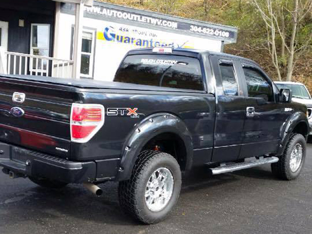This undated photo provided by the Monongalia County Homeland Security Emergency Mangement Agency shows a black Ford F-150 extended cab that authorities are seeking in connection with a shooting t ...