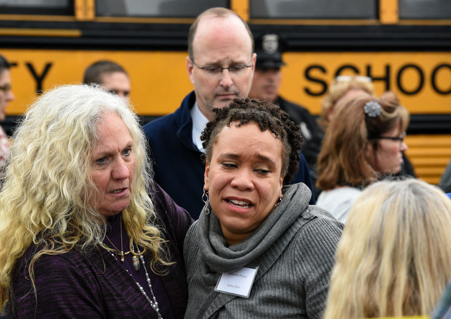 Clovis Stair, left, supervisor of Knox County School psychology, consoles Sunnyview Primary School Principal Sydney Upton near the scene where two school buses serving Chilhowee Intermediate Schoo ...