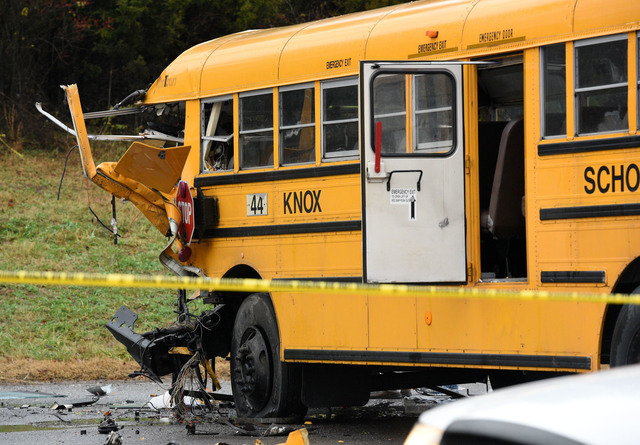 Police rope off the scene of an accident involving two school buses in Knoxville, Tuesday, Dec. 2, 2014. Two school buses have collided on a Tennessee highway, injuring at least 20 people. (AP Pho ...