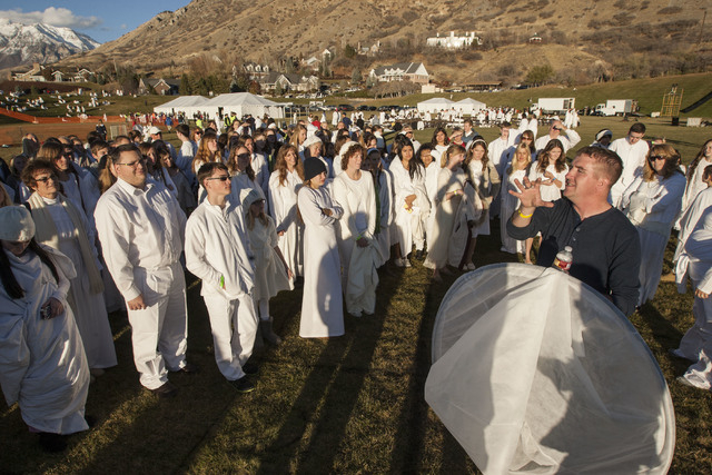 More than 1,000 participants gather at Rock Canyon Park in Provo, Utah, on Monday, Dec. 1, 2014, in an attempt to set a world record for the largest recreation of a live Nativity scene. The event  ...