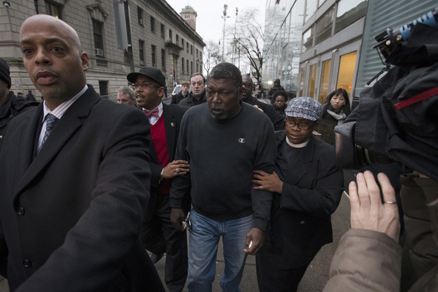 Benjamin Carr, relative of Eric Garner, leaves the district attorney's office after a grand jury's decision not to indict a New York police officer involved in the death of Garner, Wednesday, Dec. ...