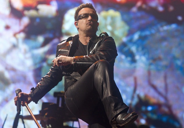 Bono, of British rock band U2, performs at Glastonbury Music Festival in Glastonbury, England, June 24, 2011. The band opens a 19-city tour next May. (Joel Ryan/AP)