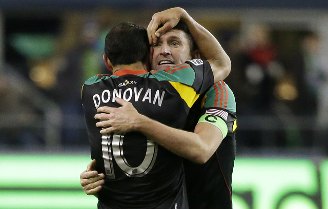 Los Angeles Galaxy captain Robbie Keane, right, hugs Landon Donovan (10) after the Galaxy won the MLS western conference championship, Sunday, Nov. 30, 2014, in Seattle. Sunday's soccer match ende ...
