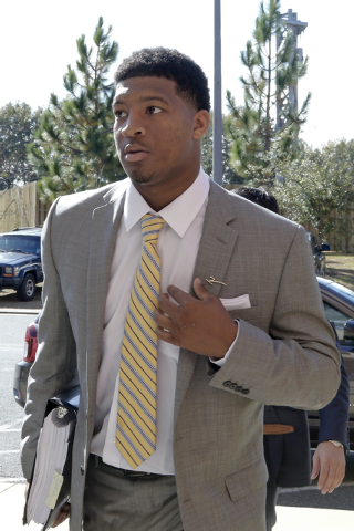 Florida State NCAA college football quarterback Jameis Winston arrives at Florida State's Materials Research building for his student code on conduct hearing, Tuesday, Dec. 2, 2014, in Tallahassee ...