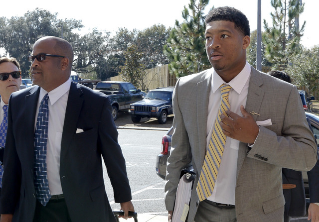 Florida State NCAA college football quarterback Jameis Winston, right, and his attorney David Cornwell arrive at Florida State's Materials Research building for his student code on conduct hearing ...