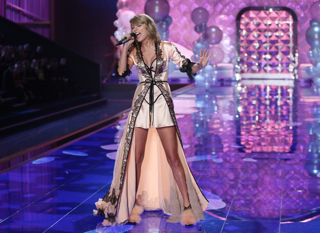 """Taylor Swift performs at the Victoria's Secret fashion show in London, Tuesday, Dec. 2, 2014. Swift received a Grammy nomination for Record of the Year for """"Shake It Off"""" on Friday, Dec. 5. The Re ..."""