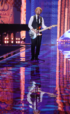 """Singer Ed Sheeran performs at the Victoria's Secret fashion show in London, Tuesday, Dec. 2, 2014. Sheeran received a Grammy nomination for pop vocal album for """"X"""" on Friday, Dec. 5. The Recor ..."""