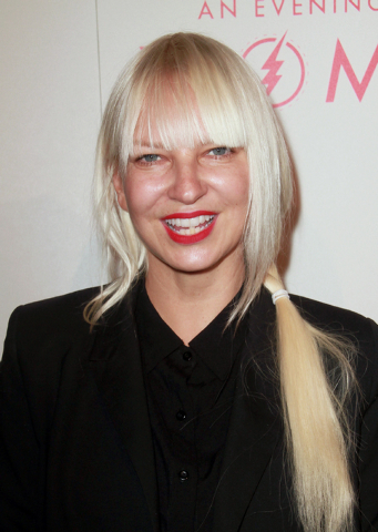 """Sia arrives at The L.A. Gay and Lesbian Center's Annual """"An Evening With Women"""" at The Beverly Hilton in Beverly Hills, California, May 10, 2014. Sia's """"Chandelier"""" is up for record of the year, o ..."""