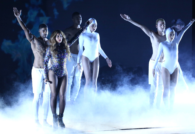 Beyonce performs on stage at the MTV Video Music Awards at The Forum in Inglewood, California, Aug. 24, 2014. Beyonce's self-titled fifth album received a nomination for urban contemporary album o ...
