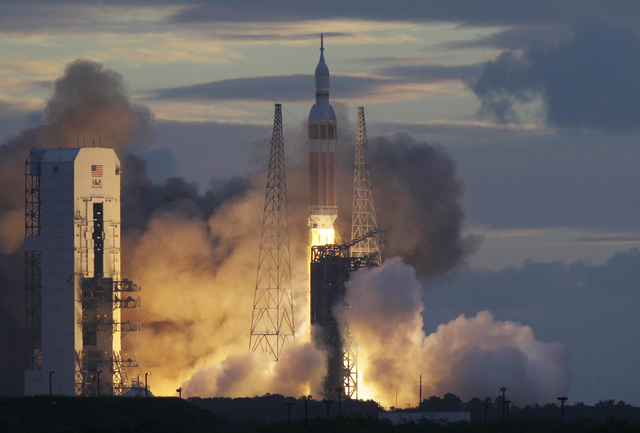 A NASA Orion capsule on top of a Delta IV rocket lifts off on its first unmanned orbital test flight from Complex 37 B at the Cape Canaveral Air Force Station, Friday, Dec. 5, 2014 at Cape Canaver ...