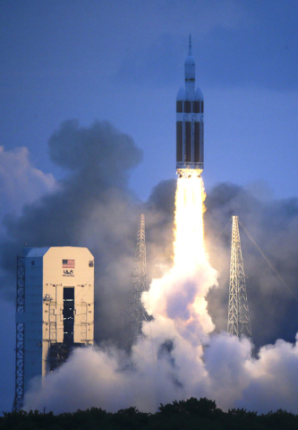 The NASA Orion space capsule atop a Delta IV rocket, in its first unmanned orbital test flight, lifts off from the Space Launch Complex 37B pad at the Cape Canaveral Air Force Station,  Friday, De ...