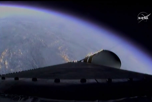 This photo provided by NASA-TV, shows the view from the Orion spacecraft atop a United Launch Alliance Delta 4-Heavy rocket as it climbs to orbit during the first test flight, Friday Dec. 5, 2014. ...