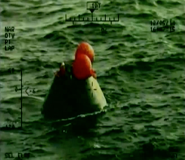 In this frame grab from NASA-TV, the Orion capsule floats after splashing down in the Pacific Ocean, Friday, Dec. 5, 2014, following a dramatic test flight that took it to a zenith height of 3,600 ...