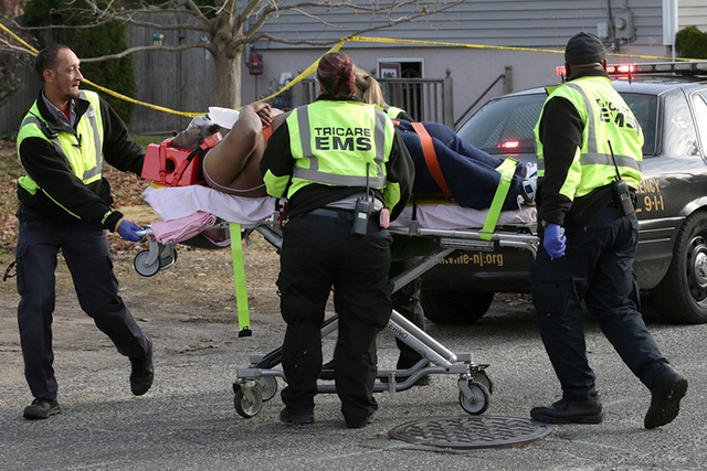 Emergency personnel take shooting victim, rapper Beanie Sigel, from a house on Spruce Avenue in Plesantville, N.J. on Friday Dec. 5, 2014, where he and another man were wounded. Sigel, whose real  ...