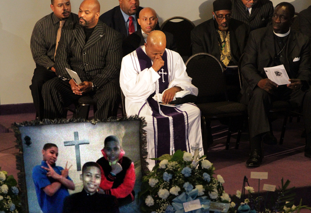 Pastor Henry Currie of Mary B. Wise Baptist Church collects himself during services for Tamir Rice, Wednesday, Dec. 3, 2014, in Willoughby, Ohio. Rice, 12, was shot and killed by a Cleveland polic ...