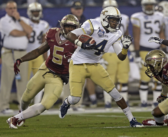 Georgia Tech defensive back Jamal Golden (4) runs past Florida State linebacker Reggie Northrup (5) during the first half of the Atlantic Coast Conference championship NCAA college football game i ...