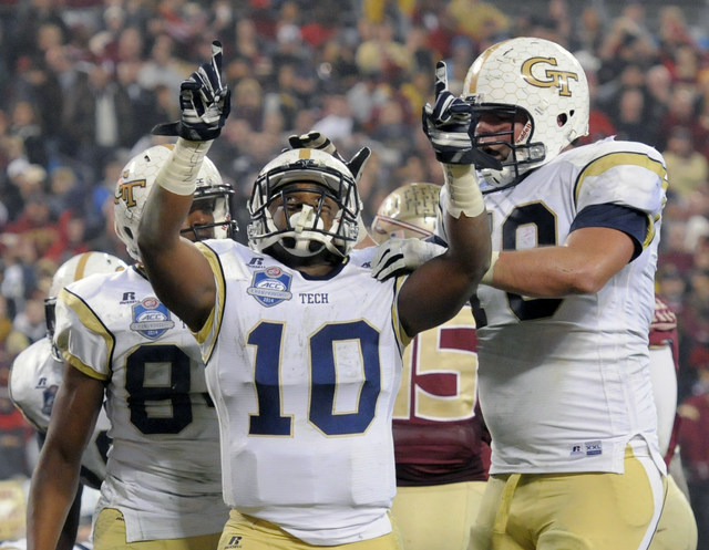 Georgia Tech running back Synjyn Days (10) celebrates his touchdown run against Florida State with offensive lineman Shaquille Mason, right, during the first half of the Atlantic Coast Conference  ...