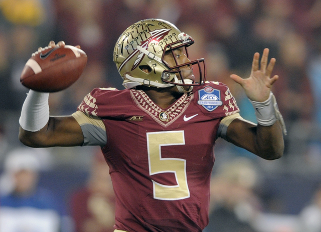 Florida State quarterback Jameis Winston (5) looks to pass against Georgia Tech during the first half of the Atlantic Coast Conference championship NCAA college football game in Charlotte, N.C., S ...