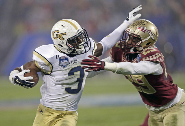 Georgia Tech running back Dennis Andrews (3) tries to break the tackle of Florida State defensive back Nate Andrews (29) during the first half of the Atlantic Coast Conference championship NCAA co ...