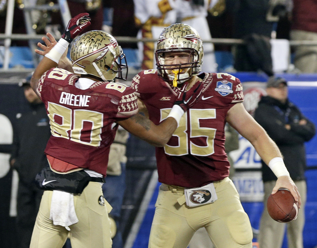 Florida State tight end Nick O'Leary (35) celebrates his touchdown against Georgia Tech with wide receiver Rashad Greene (80) during the first half of the Atlantic Coast Conference championship NC ...