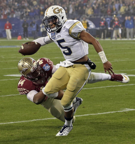 Georgia Tech quarterback Justin Thomas (5) is tackled by Florida State defensive end DeMarcus Walker (44) during the first half of the Atlantic Coast Conference championship NCAA college football  ...