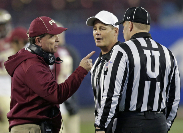 Florida State head coach Jimbo Fisher, left, talks to officials during the first half of the Atlantic Coast Conference championship NCAA college football game against Georgia Tech in Charlotte, N. ...