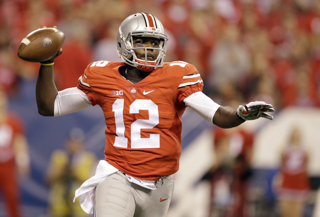 Ohio State quarterback Cardale Jones throws during the first half of the Big Ten Conference championship NCAA college football game against Wisconsin Saturday, Dec. 6, 2014, in Indianapolis. (AP P ...