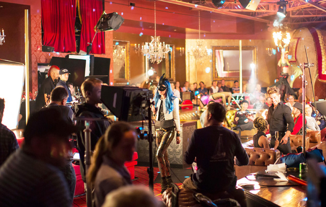 In this Oct. 14, 2014 photo from the Las Vegas Convention and Visitors Authority, actors and crewmembers record a segment of a dual-purpose ad video - to promote both Las Vegas and indie-rock band ...