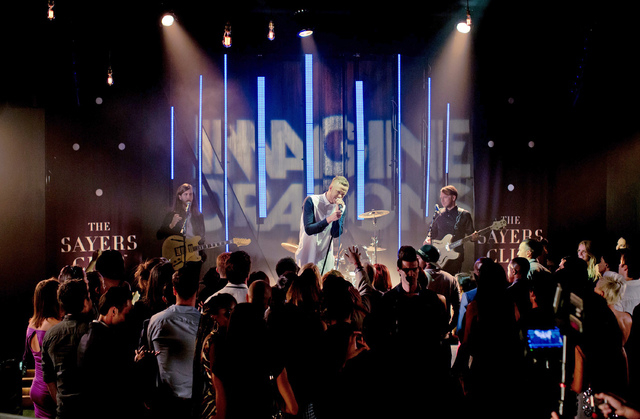 In this Oct. 13, 2014, photo from the Las Vegas Convention and Visitors Authority, Imagine Dragons and lead singer Dan Reynolds are recorded during a segment of a dual-purpose ad video, to promote ...