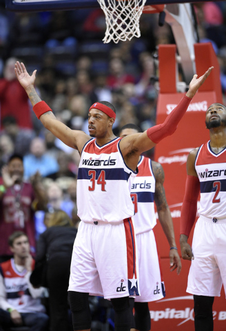 Washington Wizards forward Paul Pierce (34) raises his arms as he acknowledges the crowd after it was announced that he is now 16th all-time in points scored during the first half of an NBA basket ...