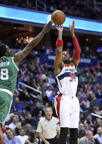 Washington Wizards forward Paul Pierce (34) takes a shot against Boston Celtics forward Jeff Green (8) during the first half of an NBA basketball game, Monday, Dec. 8, 2014, in Washington. The Wiz ...